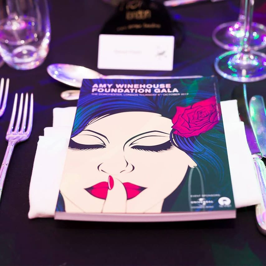 A Photograph of the event brochure on the table