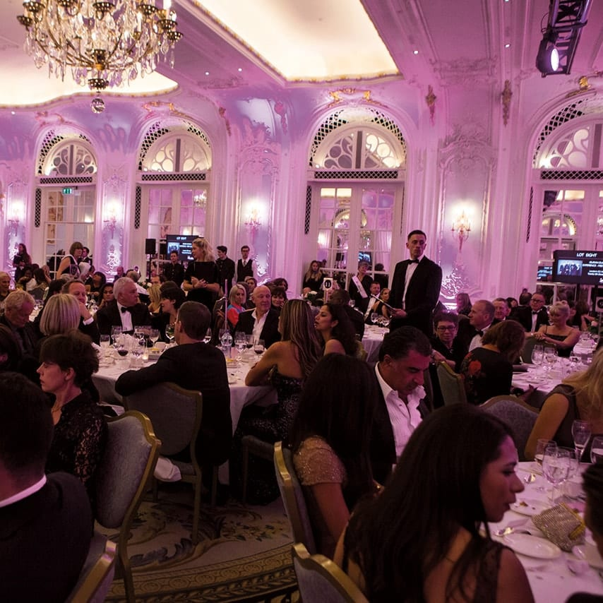 A photo of people seated and dining at the Dorchester hotel London during the charity gala
