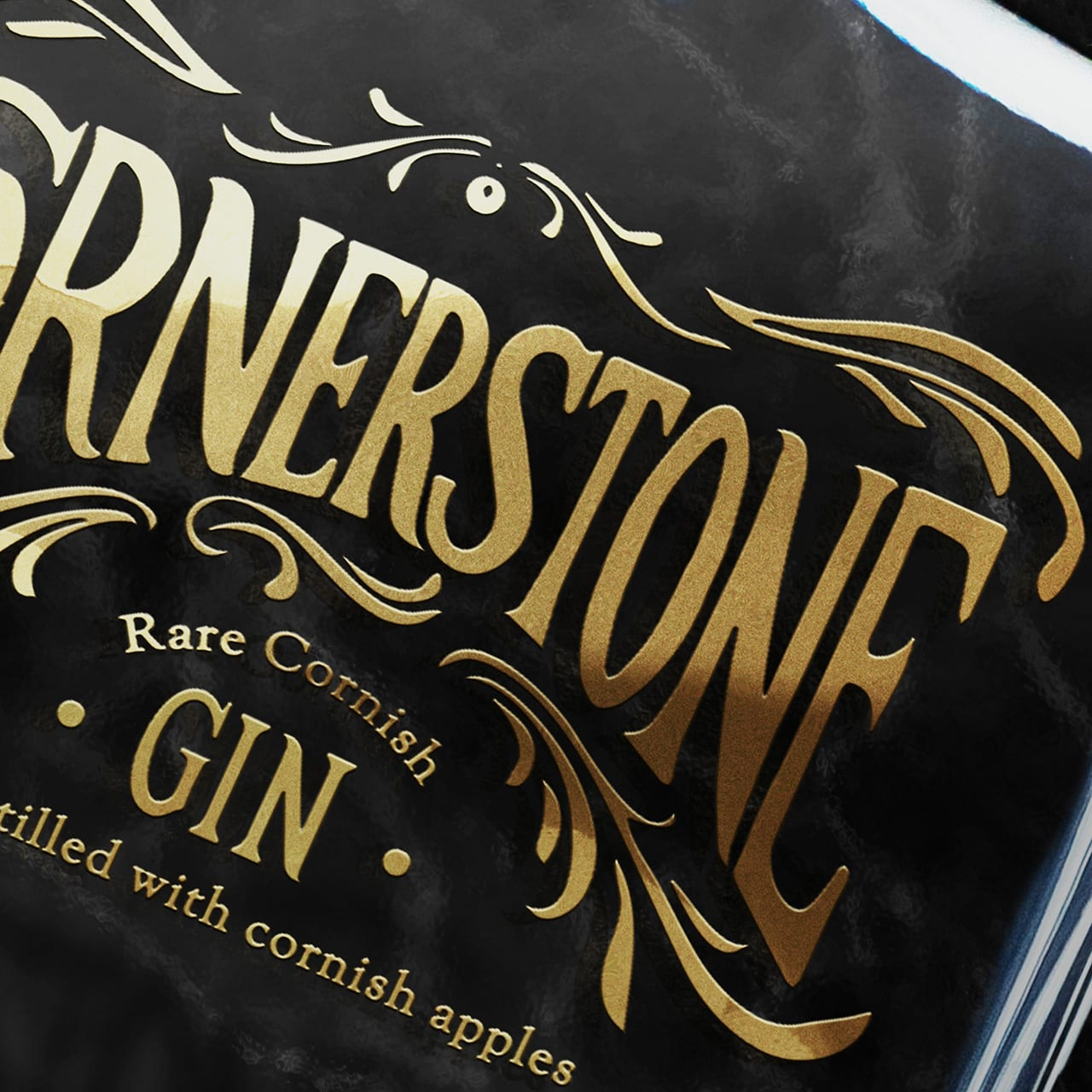 A close-up image of the Cornerstone gin bottle branding